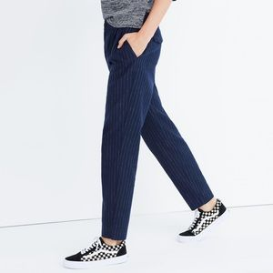 Madewell blue track trousers with white stripes.